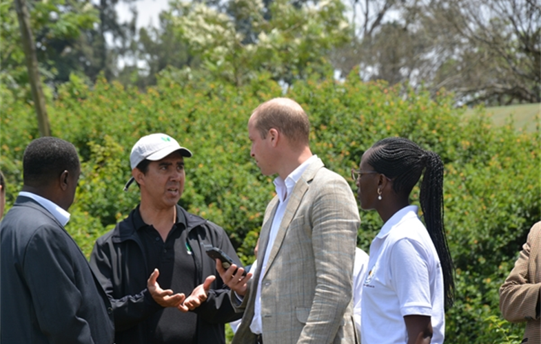 Dr. Tony Lynam (left), the Duke of Cambridge (center), and CAWM Instructor Elizabeth Kamili discuss how to record an observation with the Cybertracker-equipped smartphone. CREDIT: College of African Wildlife Management-Mweka